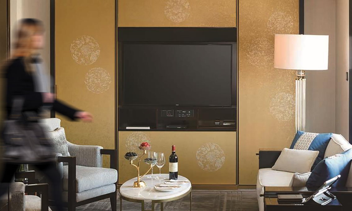 Custom wallpaper for TVB cabinet surface in suite
